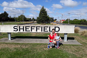 Last years winner of the PolyMax prize next to a Sheffield sign