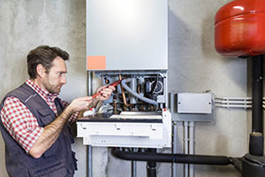 Plumber fixing gas central boilers