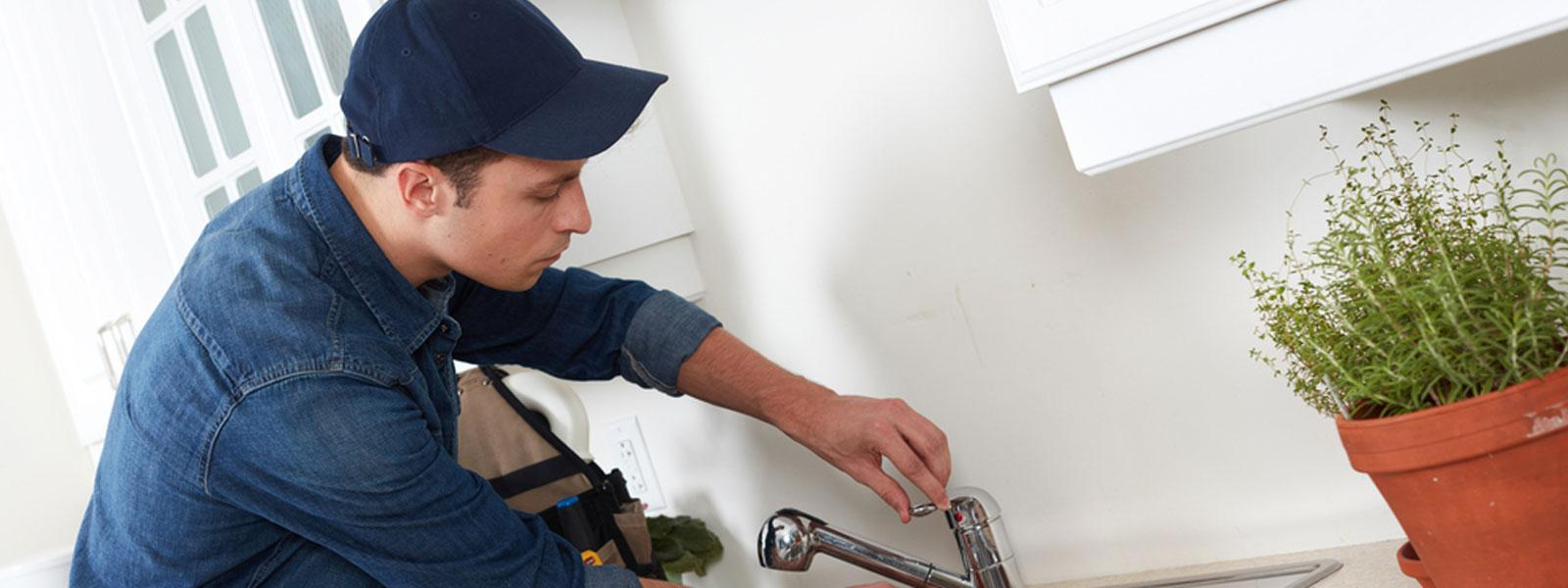 self-employed plumber fixing sink