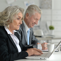 Ageing workforce – two mature workers at computers