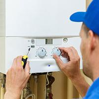 plumber servicing boiler to prevent carbon monoxide poisoning
