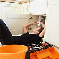 Female Plumber working with Watersafe