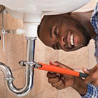 Happy plumbers