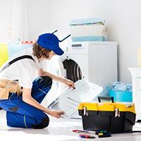 Apprenticeship plumber fixing washing machine