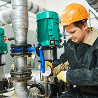 Man fixing a Together Energy heating pump