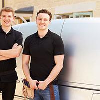 Plumbers by their work van