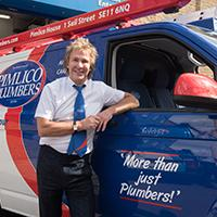Pimlico owner stood next to plumbing van