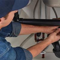 Plumber under sink - Plumber Earnings Heat Up In July