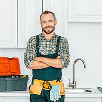 Plumber smiling about the plumbing bursary being back