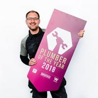 Steve Bartin holding Plumber Of The Year sign