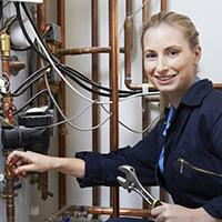 Female plumbing employee - health & safety